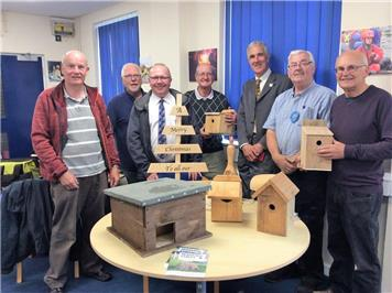 Judges Ian and Tony with SHed members and some completed project items - South West in Bloom at the RWB Shed